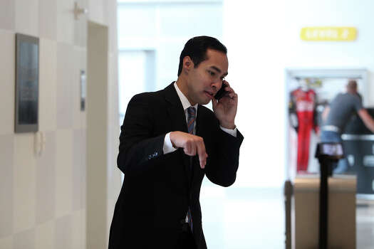 Mayor Julian Castro does a radio interview over the phone amid preparations for the start of the Democratic National Convention in Charlotte, NC on Tuesday, Sept. 4, 2012. Photo: Lisa Krantz, San Antonio Express-News / San Antonio Express-News