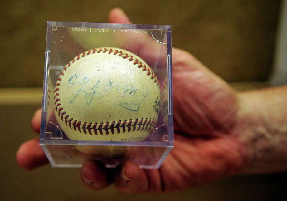 This baseball signed by Cy Young will be part of the new youth sports exhibit at the Stamford Historical Society when it opens September 12. Photo: Lindsay Niegelberg / Stamford Advocate