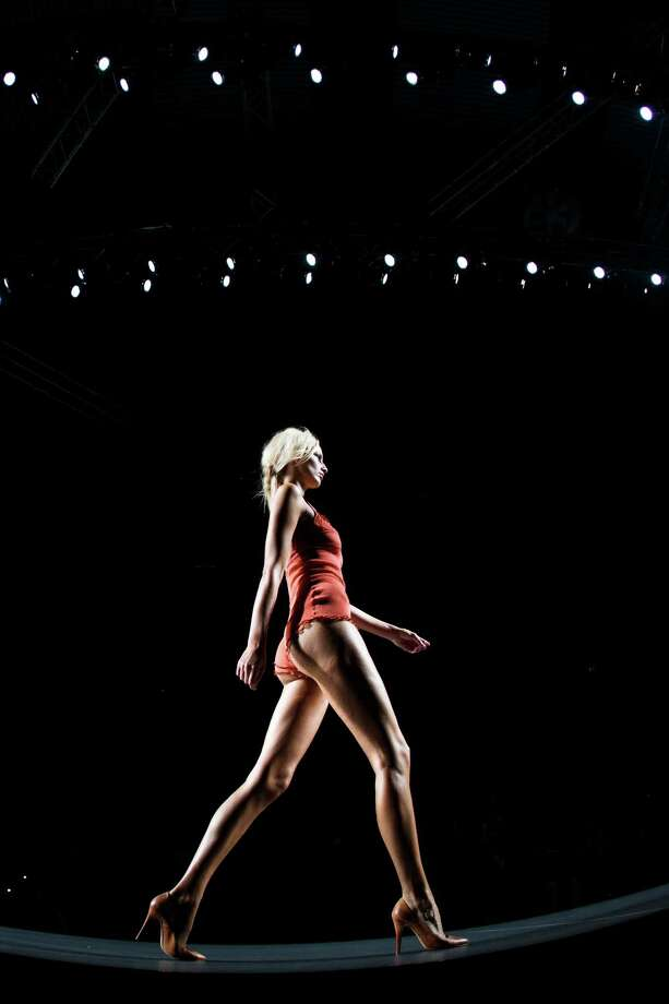 A model displays a Spring/Summer design by TCN during Madrid's Mercedes Benz Fashion Week, in Madrid, Monday, Sept. 3, 2012. (AP Photo/Daniel Ochoa De Olza) Photo: Associated Press