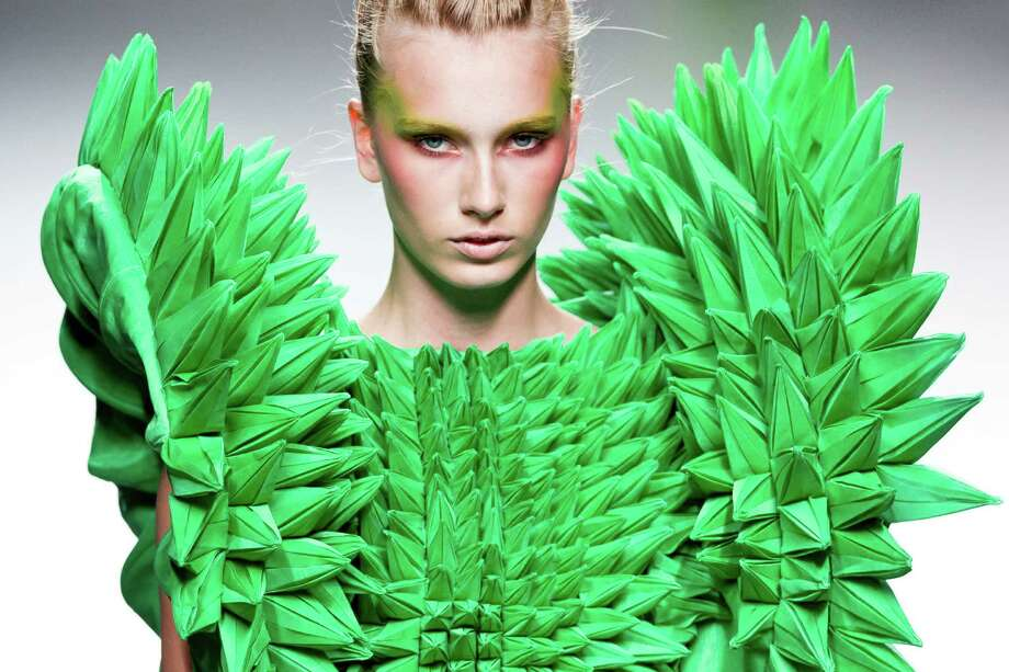 A model displays a spring/summer design by Eva Soto during the Madrid's Mercedes Benz Fashion Week, in Madrid on Monday. (AP Photo/Daniel Ochoa De Olza) Photo: Associated Press