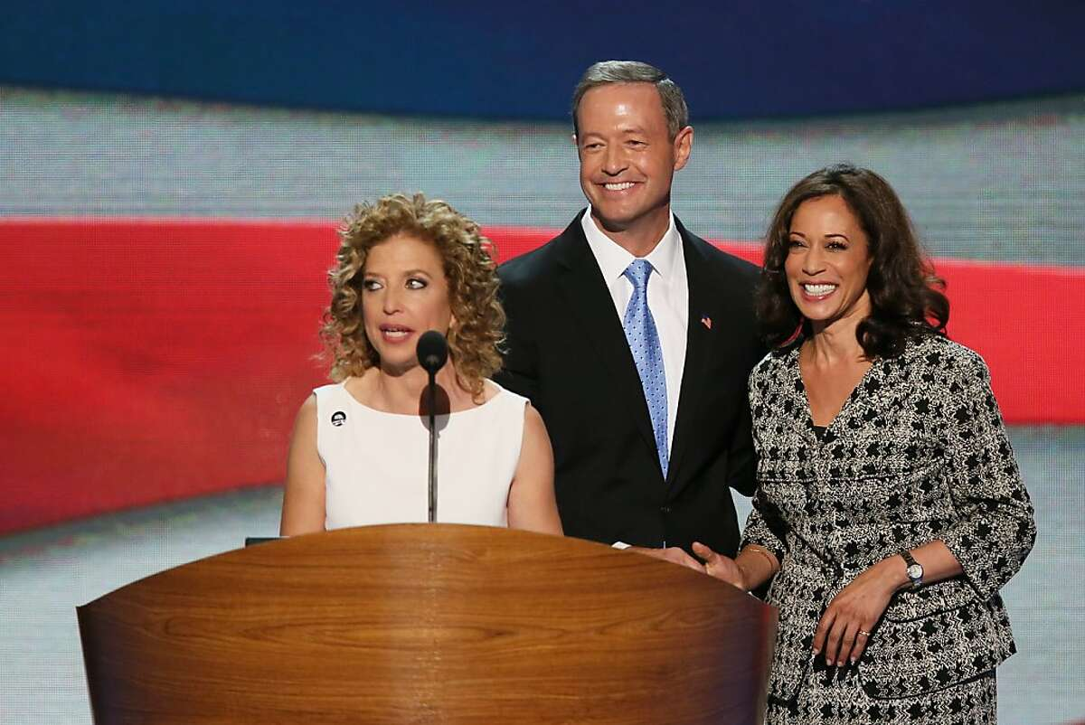CHARLOTTE, NC - SEPTEMBER 04: Co-Chairs of the Rules Committee, California Attorney General Kamala D. Harris and Maryland Gov. Martin OÂ'Malley stand as Democratic National Committee Chair, U.S. Rep. Debbie Wasserman Schultz (D-FL) speaks during day one of the Democratic National Convention at Time Warner Cable Arena on September 4, 2012 in Charlotte, North Carolina. The DNC that will run through September 7, will nominate U.S. President Barack Obama as the Democratic presidential candidate. (Photo by Alex Wong/Getty Images)