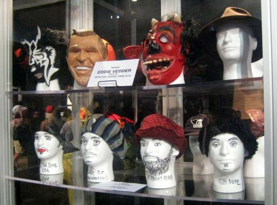 Masks worn by Pearl Jam singer Eddie Vedder on the 2004 Vote for Change tour and hats worn by bassist Jeff Ament.