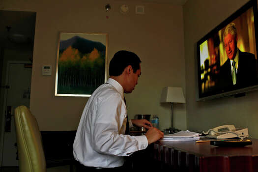 Mayor Julian Castro reads over his keynote speech in his hotel room a few hours before the start of the Democratic National Convention in Charlotte, NC on Tuesday, Sept. 4, 2012. Photo: Lisa Krantz, San Antonio Express-News / San Antonio Express-News