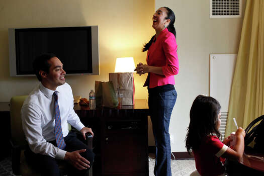 Mayor Julian Castro takes a break from rehearsing his keynote speech with his wife, Erica Castro, and their daughter, Carina, 3, in their hotel room a few hours before the start of the Democratic National Convention in Charlotte, NC on Tuesday, Sept. 4, 2012. Photo: Lisa Krantz, San Antonio Express-News / San Antonio Express-News