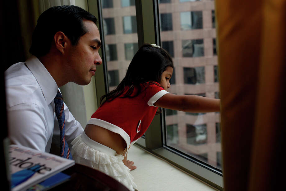 Carina Castro, 3, shows her father, Mayor Julian Castro, where she walked on the street below with her mother to pick up their lunch from Panera Bread in their hotel room as he prepares for his keynote speech during the Democratic National Convention in Charlotte, NC on Tuesday, Sept. 4, 2012. Photo: Lisa Krantz, San Antonio Express-News / San Antonio Express-News