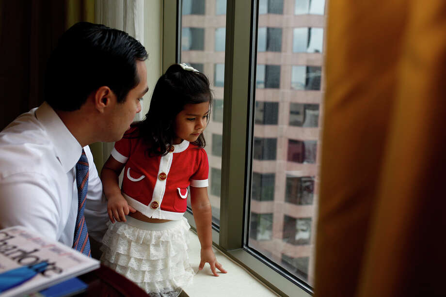 Carina Castro, 3, shows her father, Mayor Julián Castro, where she walked with her mom on the street below their hotel room to pick up lunch in Charlotte, N.C. Photo: Lisa Krantz, San Antonio Express-News / San Antonio Express-News
