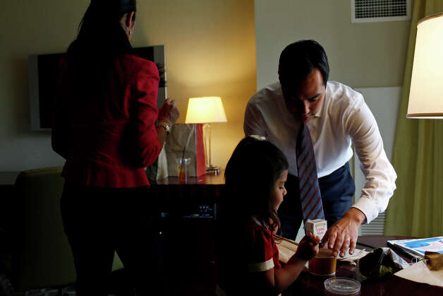 Mayor Julian Castro takes a lunch break with his wife, Erica Castro, and their daughter, Carina, 3, in their hotel room as he prepares for his keynote speech during the Democratic National Convention in Charlotte, NC on Tuesday, Sept. 4, 2012. Photo: Lisa Krantz, San Antonio Express-News / San Antonio Express-News