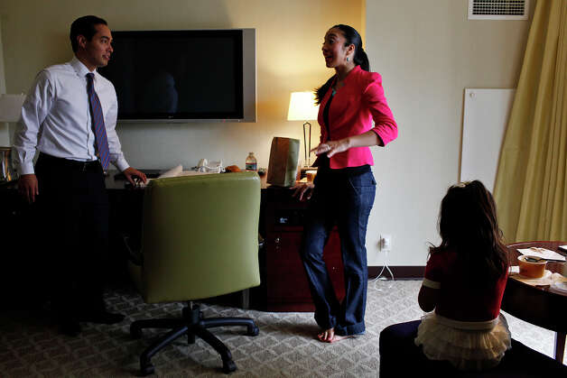 Mayor Julian Castro takes a break with his wife, Erica Castro, and their daughter, Carina, 3, in their hotel room as he prepares for his keynote speech during the Democratic National Convention in Charlotte, NC on Tuesday, Sept. 4, 2012. Photo: Lisa Krantz, San Antonio Express-News / San Antonio Express-News