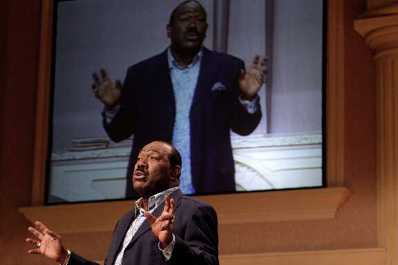 Bishop I.V. Hilliard speaking during service at New Light Church, 1535 Greensmark,  Sunday, Aug. 26, 2012, in Houston.  Bishop I.V. Hilliard is celebrating 50 years in his ministry. He is head of the New Light Church, a megachurch with numerous locations, many of them in Houston.  ( Melissa Phillip / Houston Chronicle )