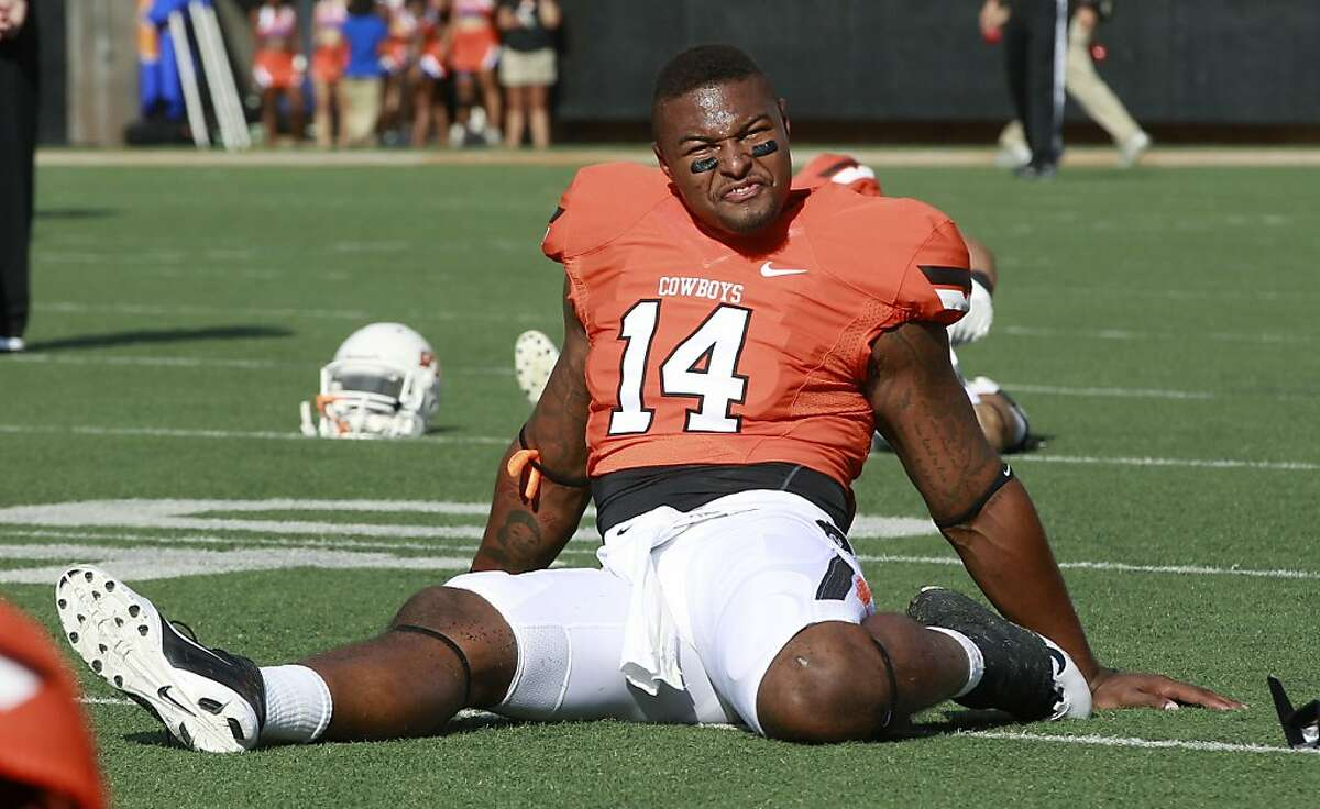 Oklahoma State tight end Justin Horton stretches before an NCAA college football game against Savannah State in Stillwater, Okla., Saturday, Sept. 1, 2012. (AP Photo/Sue Ogrocki)