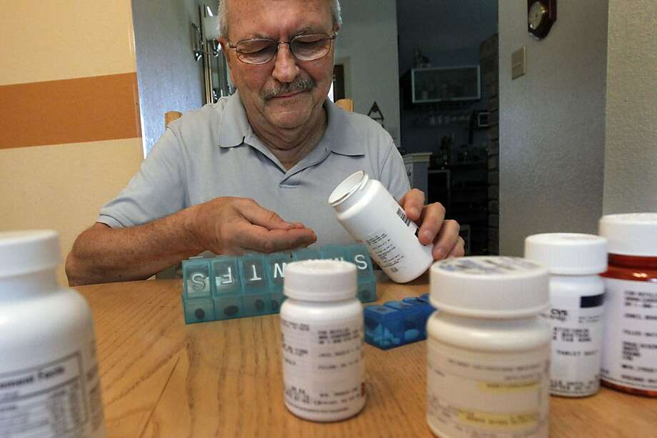 Bengt Bostrom, 71, organizes his medications on July 3, 2012 at his home in Coppell, Texas. (Louis DeLuca/Dallas Morning News/MCT) Photo: Louis DeLuca, McClatchy-Tribune News Service