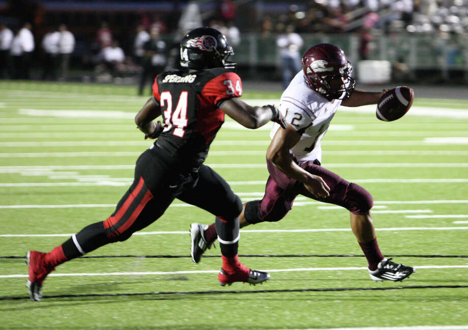 Central quarterback Robert Mitchell looks for yardage against Port Arthur Memorial on Aug. 31, 2012 at Memorial Stadium. Photo: Matt Billiot
