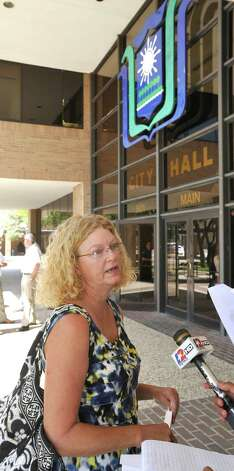 Pam Shelander, talks with the media about Ward II Councilman Mike Getz. She was not happy about some of the comments being said about the councilman during the Tuesday meeting.. Beaumont City Council met Tuesday afternoon September 4, 2012. Ricky Jason and the People of Colors  attended the meeting and spoke to Councilman Mike Getz and the rest of the council about his behavior at former BISD Superintendent Carrol Thomas' retirement party. The group then held a press conference immediately after the meeting.   Dave Ryan/The Enterprise Photo: Dave Ryan