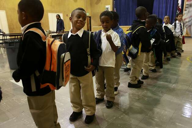 Curtis Dright III, 5, lines up with the rest of his kindergarten class on the first day of school at The 100 Black Men Community School on Tuesday Sept. 04 2012 in Oakland, Calif. Photo: Mike Kepka, The Chronicle