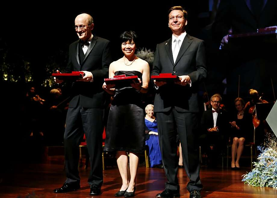 UCLA's David Jewitt (left), Jane Luu of MIT and Caltech's Michael E. Brown bask in the glow of receiving the Kavli Prize in the astrophysics category in Oslo. They discovered and characterized the Kuiper Belt. Photo: Aas, Erlend, Associated Press