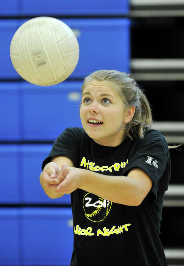 Newtown volleyball co-captain Courtney Escoda hits the ball during practice at Newtown High School on Tuesday, Sept. 4, 2012. Photo: Jason Rearick / The News-Times