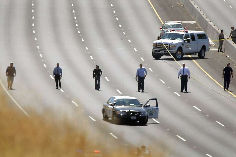 Emergency responders investigate at the scene of a shooting on Interstate 680 near Alamo, Calif. on Tuesday, September 4, 2012. A California Highway Patrol officer was conducting a traffic stop in the area when gunfire broke out. Photo: Lea Suzuki, The Chronicle