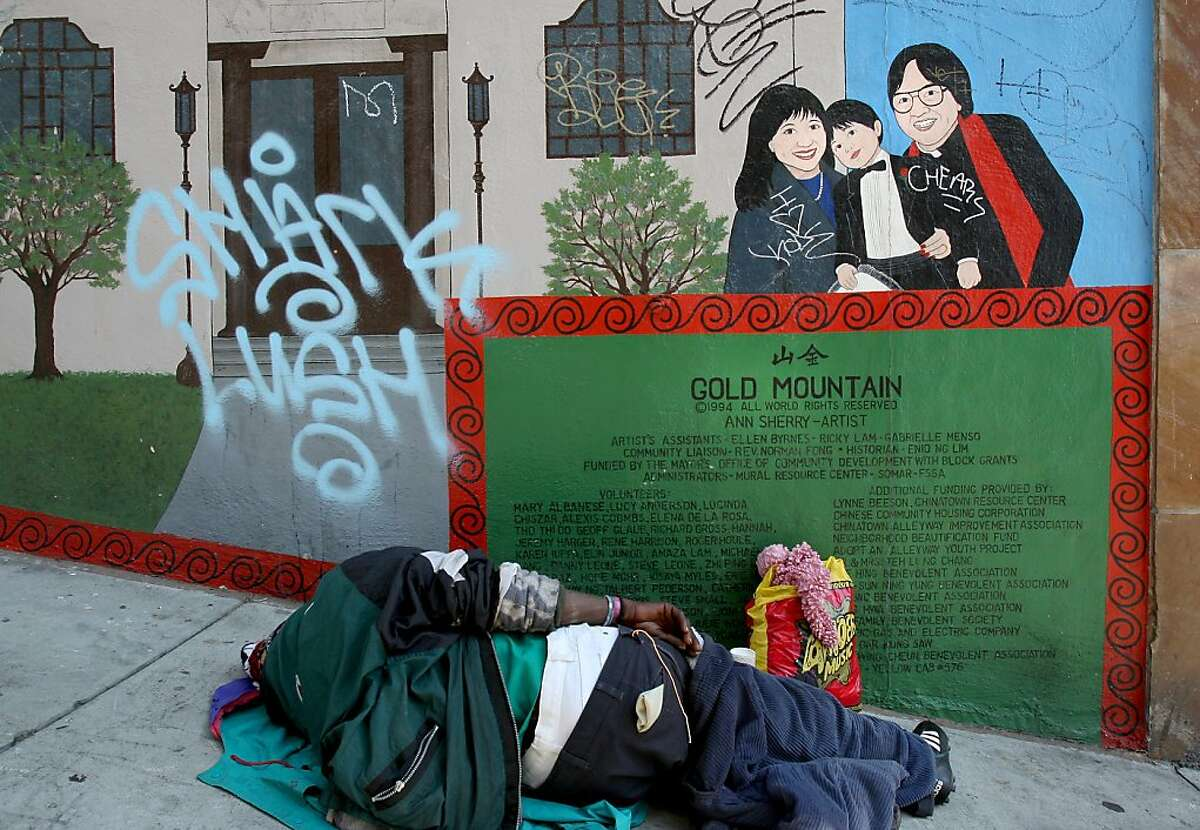 mural11_236.JPG A homeless man sleeps near the mural introduction at the corner of Romolo alley and Broadway. One of the few local monuments to Berry Ong, a San Francisco native who was killed six years ago while working on Flight 11 on Sept. 11, 2001, is a North Beach mural that has been defaced again. Ong is just one of the Chinatown luminaries honored in the mural done by Ann Sherry. Now the damage is so extensive, the mural will have to be sanded off and redone. {By Brant Ward/San Francisco Chronicle}9/10/07