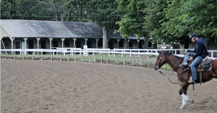 Empty barns are seen in the background just off the Oklahoma training track at the Saratoga Race Course on Tuesday morning, Sept. 4, 2012 in Saratoga Springs, NY.  Many trainers and their horses have left now that the Saratoga racing session is over.   (Paul Buckowski / Times Union) Photo: Paul Buckowski