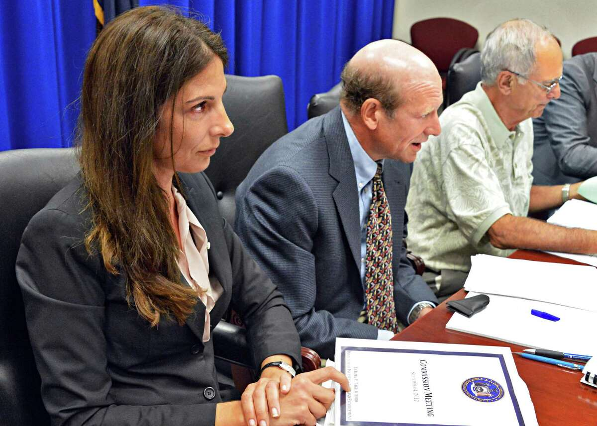 New York State Joint Commission on Public Ethics Director of Investigations Letizia Tagliafierro,left, and members George Weissman,and Patrick Bulgaro, at right, during the commission's meeting in Albany Tuesday Sept. 4, 2012. (John Carl D'Annibale / Times Union)