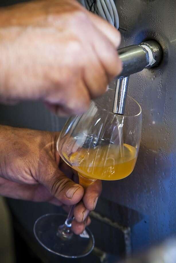Winemaker Richard Longoria tastes one of his wines. Photo: Nancy Pastor, SFC