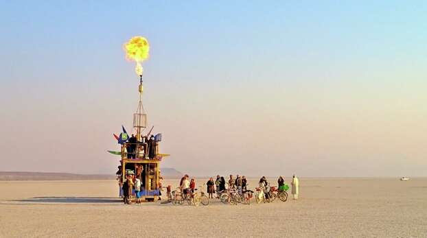 Just a little puff at sunrise at Burning Man 2013. (Photo by the goodly Jon Travis).