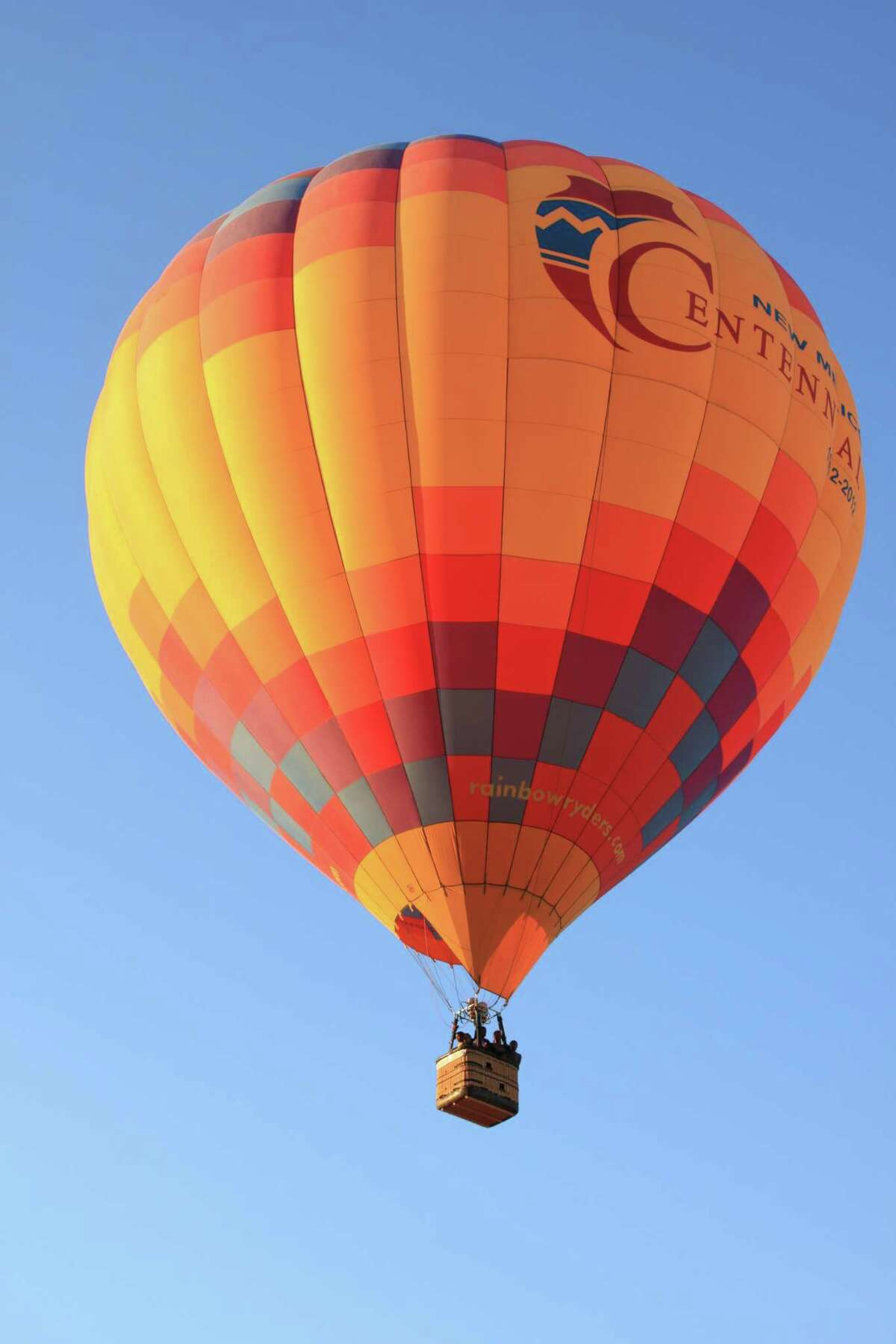 Almost every dawn of the year, hot air balloons rise like jewels in the sky over Albuquerque, New Mexico.