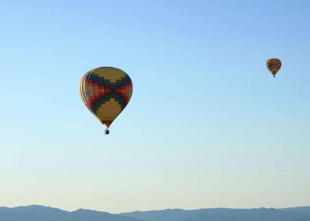 Panoramic views of mountains and desert open to hot air balloon passengers in Albuquerque, New Mexico. KATHLEEN SCOTT / For the Express-News