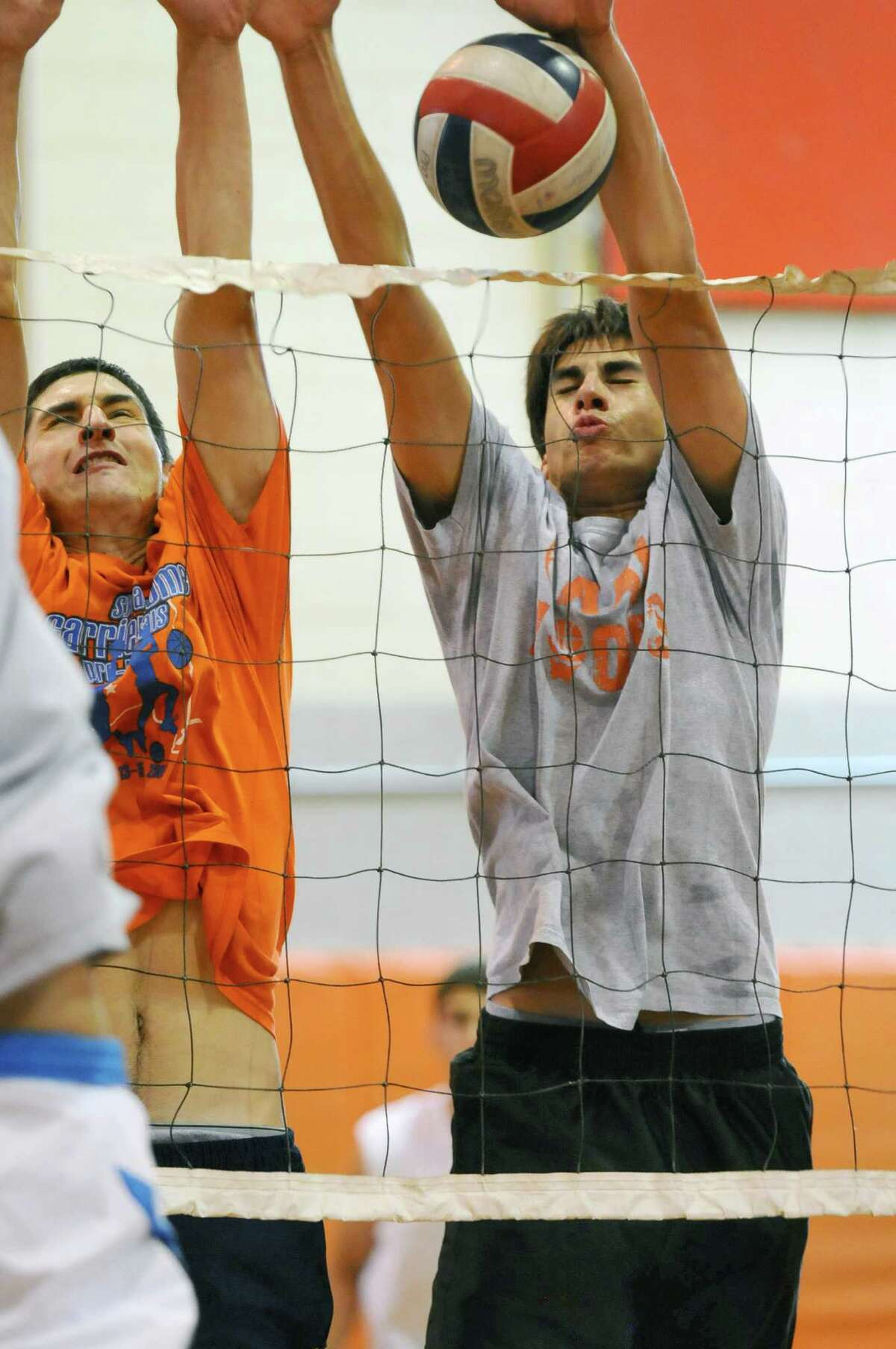 Bethlehem High Central School boys volleyball players Nate Kane, left, and Myles Bergere,right, block a shot during practice on Tuesday afternoon Sept. 4, 2012 in Delmar, NY. (Philip Kamrass / Times Union)