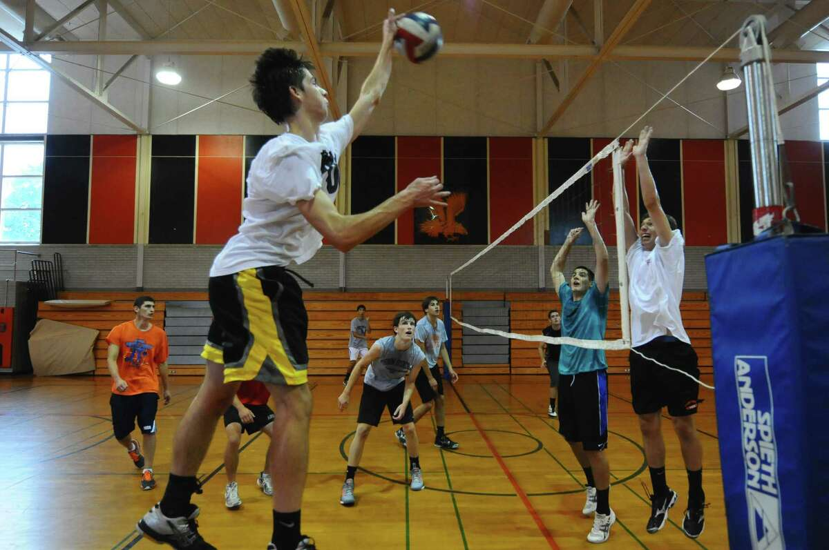 Bethlehem High Central School boys volleyball player Drew Duguid, left, hits a shot during practice on Tuesday afternoon Sept. 4, 2012 in Delmar, NY. (Philip Kamrass / Times Union)
