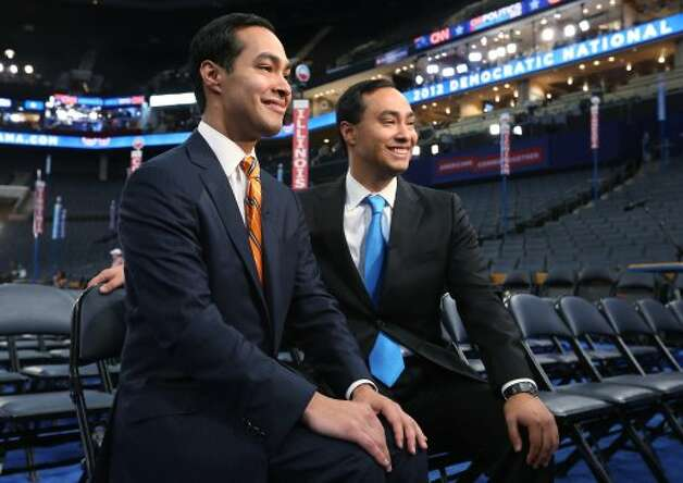 San Antonio Mayor Julian Castro, left, and his brother, state Rep. Joaquin Castro give an interview during preparations for the Democratic National Convention at Time Warner Cable Arena on Sept.  3, 2012 in Charlotte, N.C.  (Streeter Lecka / Getty Images)