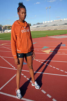 Texas sophomore Destinee Hooker jumped a personal best, an Olympic-qualifying 6 feet, 5 inches in the high jump this year. March 7, 2007. Photo: Joe Buglewicz, For The Express-News