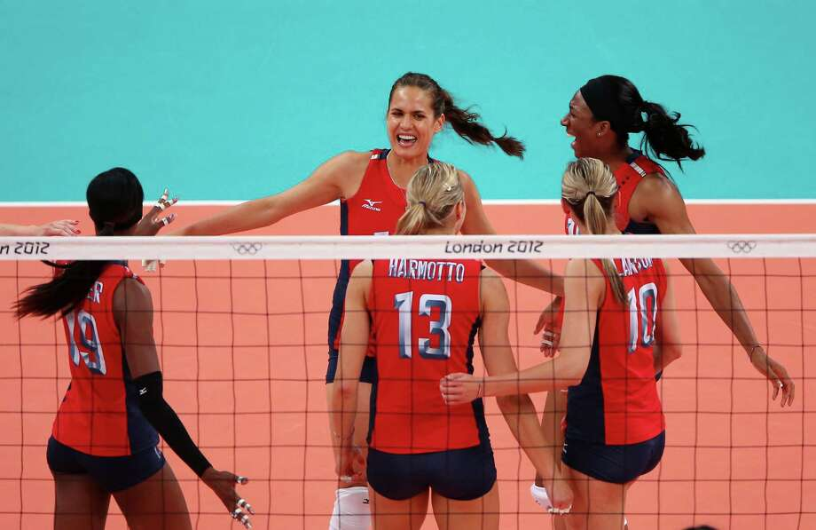 Logan Tom #15, Destinee Hooker #19, Christa Harmotto #13, Jordan Larson #10 and Foluke Akinradewo #16 of United States celebrate after a point against Korea during the Women's Volleyball semifinal match on Day 13 of the London 2012 Olympics Games at Earls Court on August 9, 2012 in London, England. Photo: Elsa, Getty Images / Getty Images Europe