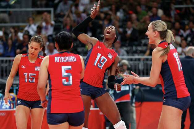 Destinee Hooker #19, Tamari Miyashiro #5, Logan Tom #15 and Jordan Larson #10 of United States celebrates after defeating Korea in the Women's Volleyball semifinal match on Day 13 of the London 2012 Olympics Games at Earls Court on August 9, 2012 in London, England. Photo: Elsa, Getty Images / Getty Images Europe
