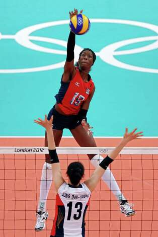 Destinee Hooker #19 of United States spikes the ball against Dae-Young Jung #13 of Korea during the Women's Volleyball semifinal match on Day 13 of the London 2012 Olympics Games at Earls Court on August 9, 2012 in London, England. Photo: Elsa, Getty Images / Getty Images Europe