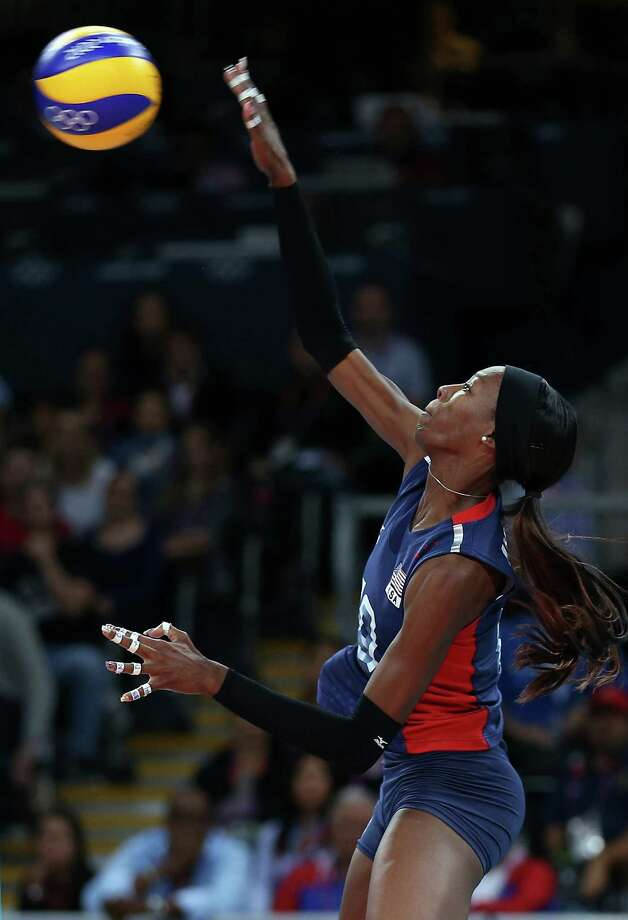Destinee Hooker #19 of the United States spikes the ball in the third set against the Dominican Republic during Women's Volleyball quarterfinals on Day 11 of the London 2012 Olympic Games at Earls Court on August 7, 2012 in London, England. Photo: Elsa, Getty Images / Getty Images Europe