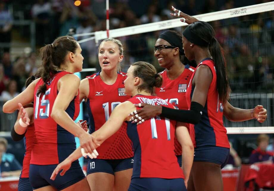 Logan Tom #15,Jordan Larson #10,Courtney Thompson #17,Foluke Akinradewo #16 and Destinee Hooker #19 of United States celebrate the win over Turkey during Women's Volleyball on Day 9 of the London 2012 Olympic Games at Earls Court on August 5, 2012 in London, England. Photo: Elsa, Getty Images / Getty Images Europe