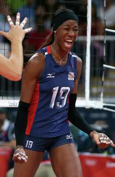 Destinee Hooker #19 of United States celebrates a point in the third set against Serbia during Women's Volleyball on Day 7 of the London 2012 Olympic Games at Earls Court on August 3, 2012 in London, England. Photo: Elsa, Getty Images / Getty Images Europe