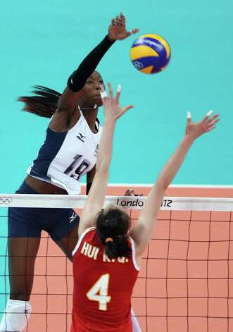 Destinee Hooker #19 of United States spikes the ball as Ruoqi Hui #4 of China defends during Women's Volleyball on Day 5 of the London 2012 Olympic Games at Earls Court on August 1, 2012 in London, England. Photo: Elsa, Getty Images / Getty Images Europe