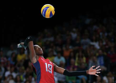 Destinee Hooker of United States serves in the Women's Volleyball Preliminary match between the United States and Brazil on Day 3 of the London 2012 Olympic Games at Earls Court on July 30, 2012 in London, England. Photo: Elsa, Getty Images / Getty Images Europe