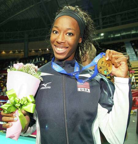Destinee Hooker shows off her gold medal after claiming Most Valuable Player honors Aug. 28, 2011, in the FIVB World Grand Prix after leading the United States past Brazil 3-0 in Macau, China. Photo: COURTESY PHOTO, Courtesy Photo