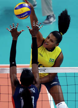 Brazil's Fernanda Rodrigues, top, spikes the ball over United States' Destinee Hooker during a women's gold medal volleyball match at the 2012 Summer Olympics, Saturday, Aug. 11, 2012, in London. Photo: Jeff Roberson, Associated Press / AP