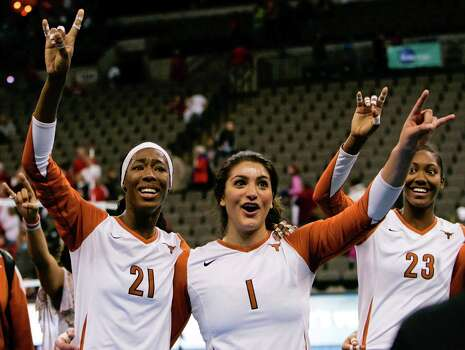 Texas' Destinee Hooker (21), Juliann Faucette (1) and Bailey Webster sing the school fight song after beating Nebraska in the NCAA college volleyball Omaha regional final match in Omaha, Neb., Saturday, Dec. 12, 2009. Texas beat Nebraska 21-25, 25-18, 25-16, 25-17. Photo: Nati Harnik, Associated Press / AP