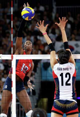 USA's Destinee Hooker (19) goes up for a smash in front of South Korea's Han Song-yi (12) during a women's volleyball semifinal match at the 2012 Summer Olympics Thursday, Aug. 9, 2012, in London. Photo: Chris O'Meara, Associated Press / AP
