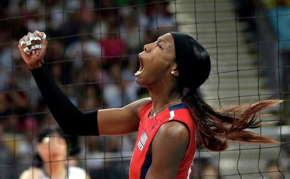 USA's Destinee Hooker (19) reacts after scoring a point against South Korea during a women's volleyball semifinal match at the 2012 Summer Olympics Thursday, Aug. 9, 2012, in London. Photo: Chris O'Meara, Associated Press / AP