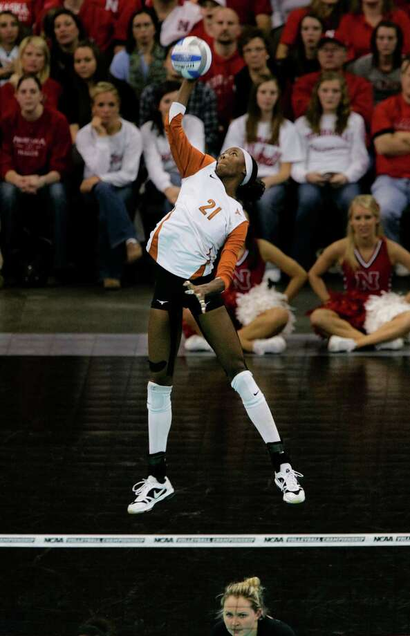 Texas' Destinee Hooker delivers a jumping serve to Nebraska in the NCAA college volleyball Omaha regional final match in Omaha, Neb., Saturday, Dec. 12, 2009. Photo: Nati Harnik, Associated Press / AP
