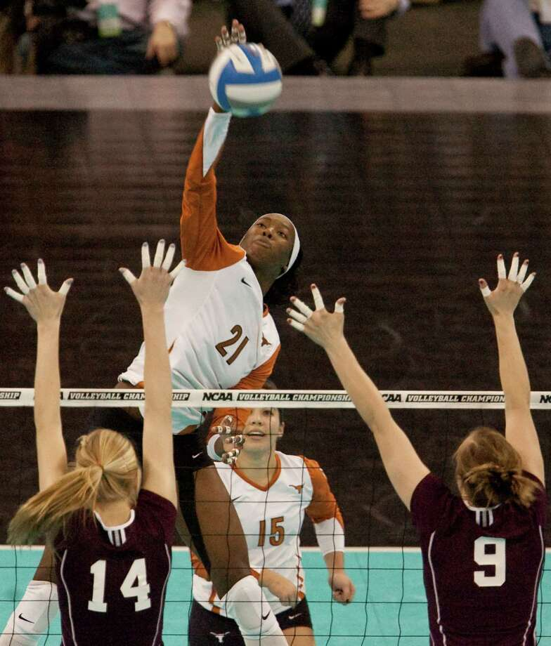 Texas' Destinee Hooker (21) goes for a kill agaisnt Texas A&M's Lindsey Miller (14) and Kristen Schevikhoven (9) in an NCAA college volleyball regional match, in Omaha, Neb., Friday, Dec. 11, 2009. Photo: Nati Harnik, Associated Press / AP