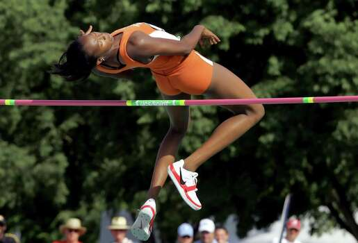 Texas' Destinee Hooker clears her jump at 6 feet, 2 1/2 inches to win the women's high jump at the NCAA track and field championships in Sacramento, Calif., Friday, June 9, 2006. Photo: JEFF CHIU, Associated Press / AP