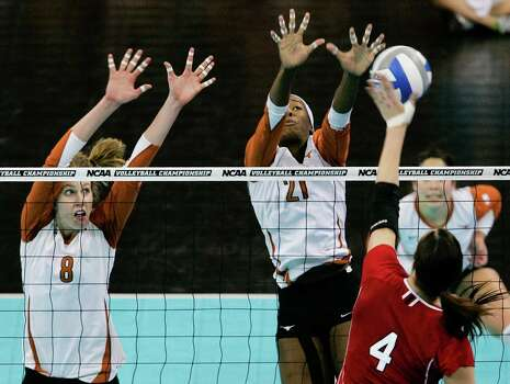 Nebraska's Lindsey Licht (4) goes for a kill against the block of Texas' Jennifer Doris (8), and Destinee Hooker (21), in the NCAA college volleyball Omaha regional final match in Omaha, Neb., Saturday, Dec. 12, 2009. Photo: Nati Harnik, Associated Press / AP