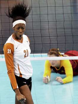 Texas' Destinee Hooker, left, celebrates a kill against Minnesota defender Hailey Cowles during their NCAA college volleyball national semifinal match Thursday, Dec. 17, 2009, in Tampa, Fla. Photo: Mike Carlson, Associated Press / FR155492 AP